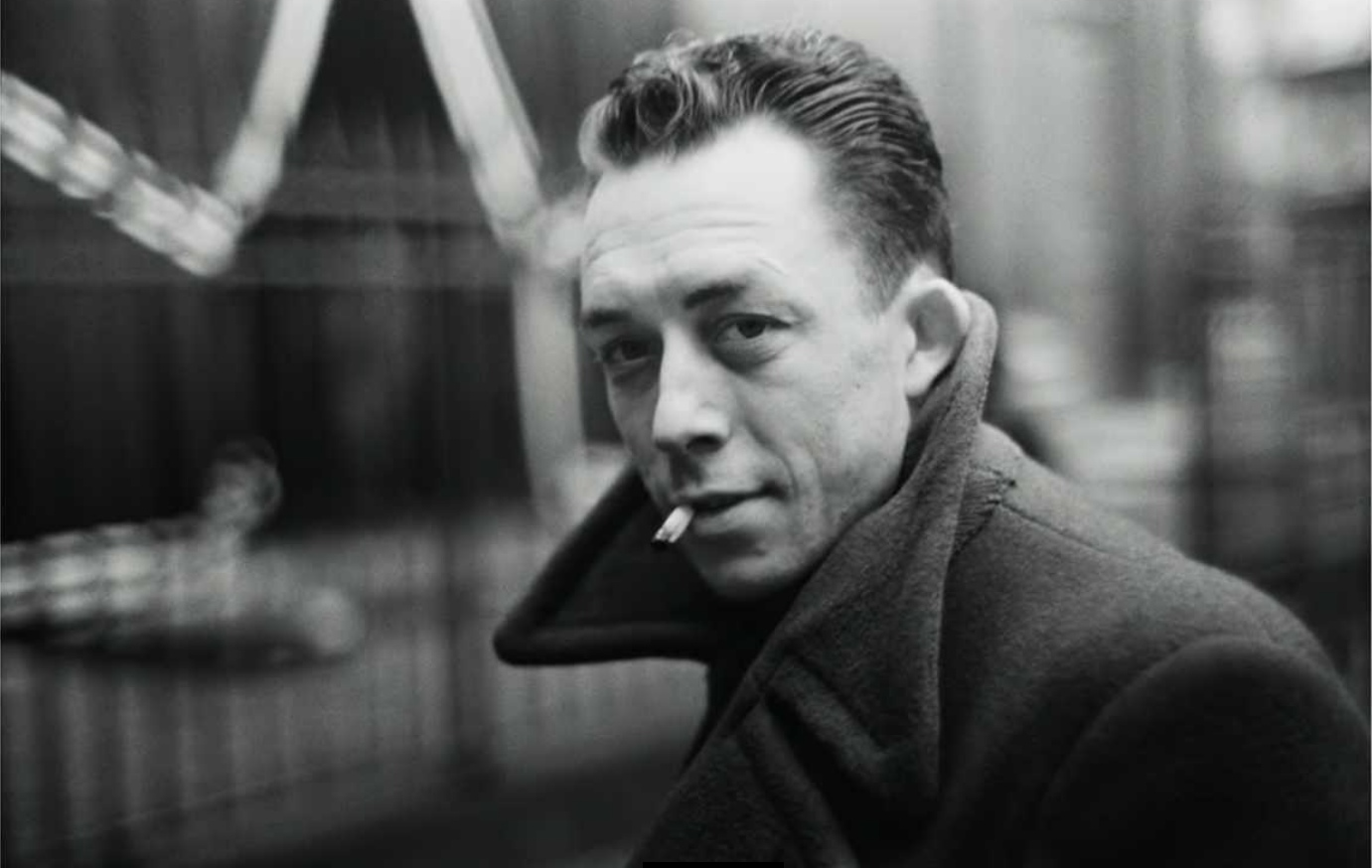 Albert Camus smoking cigarette black and white   The Lonely Tribalist