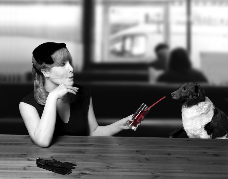 woman drinking with dog black and white | the lonely tribalist
