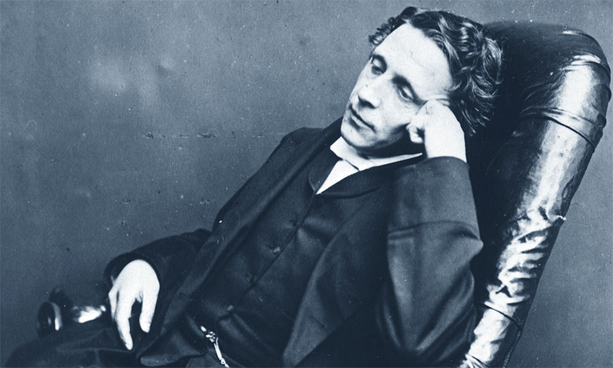 lewis carroll leaning on chair head on hand | the lonely tribalist
