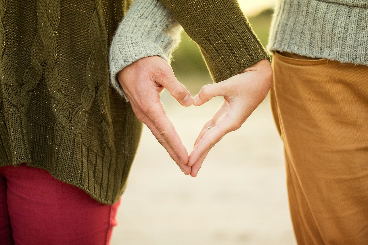 women friends holding hands heart | the lonely tribalist
