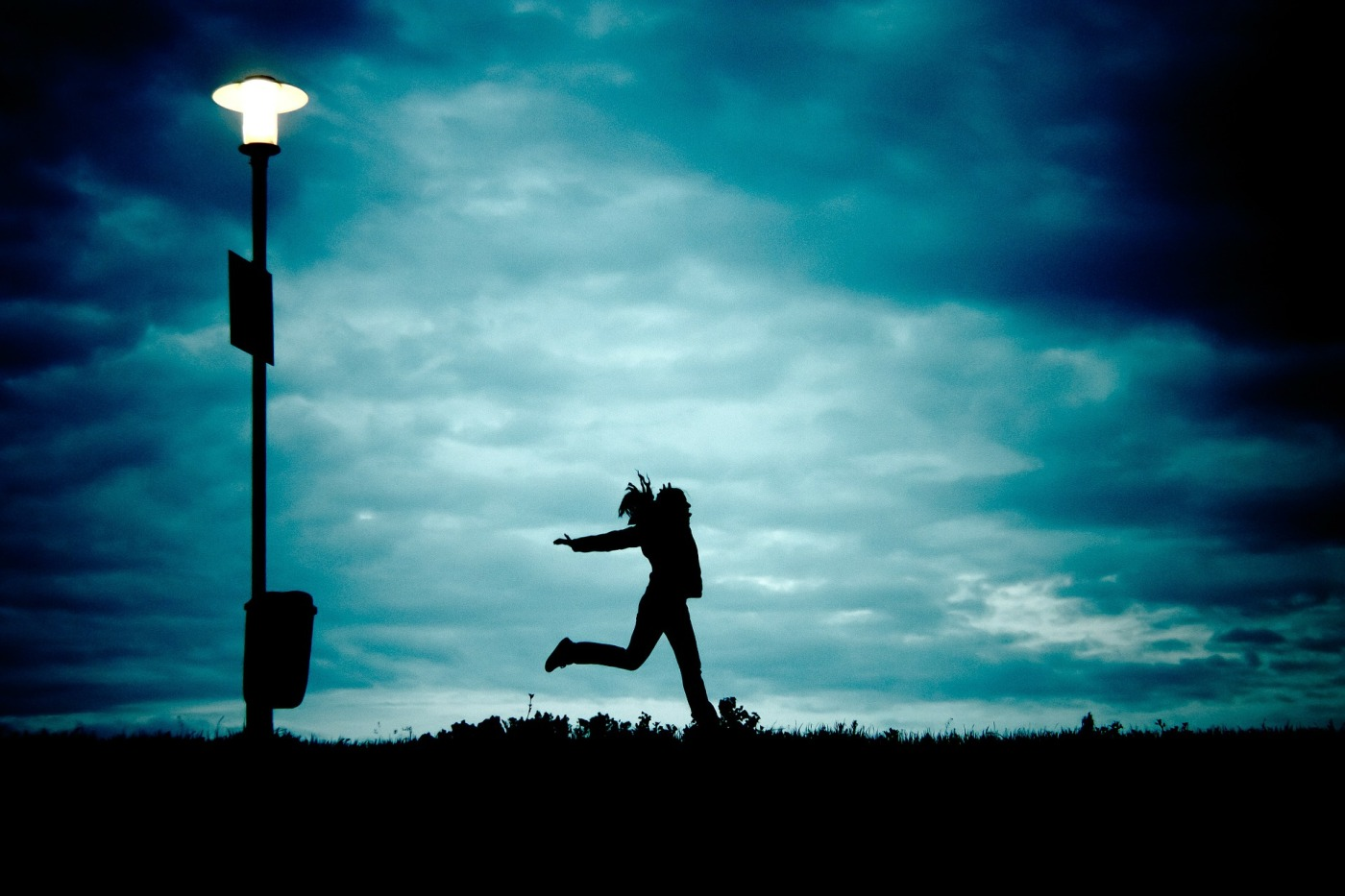 shadow silhouette girl dancing in dark night | the lonely tribalist