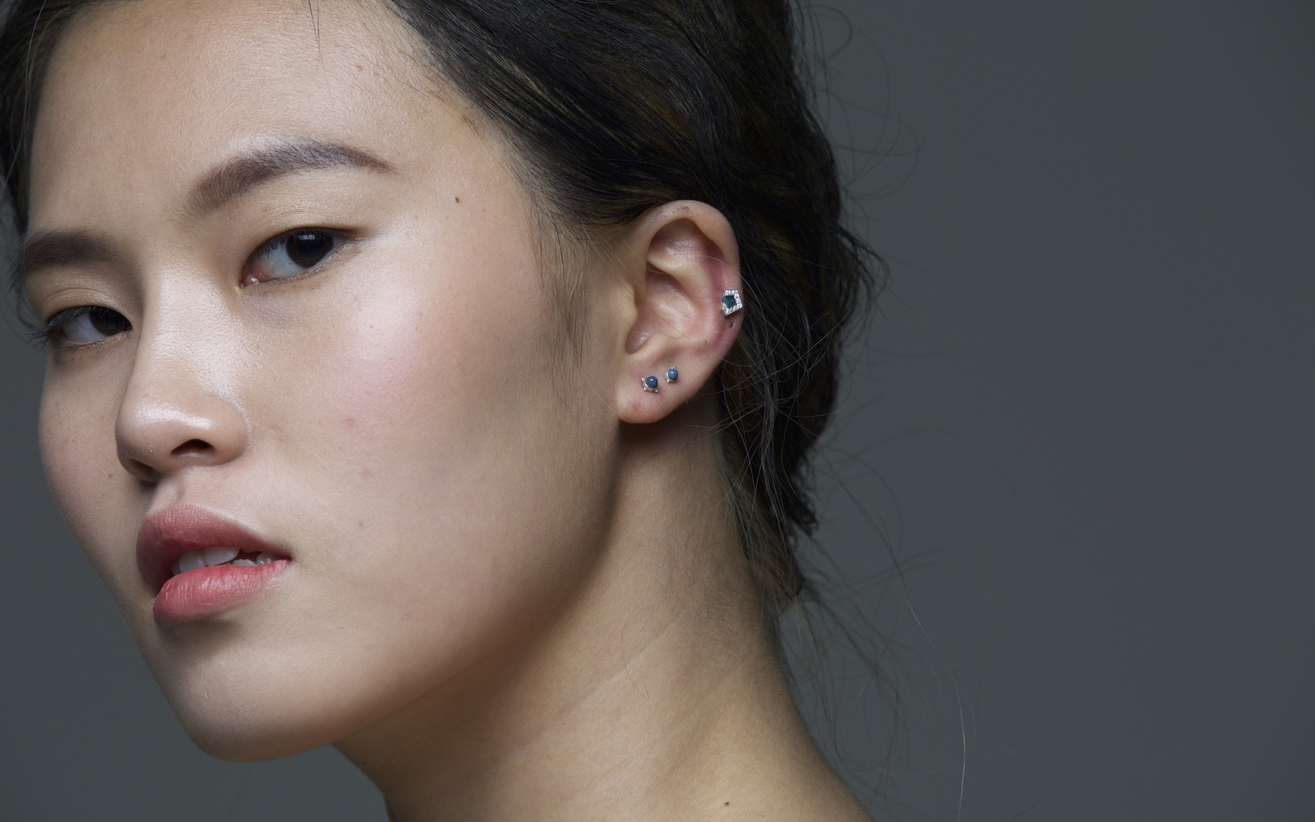 asian woman face with earrings | the lonely tribalist