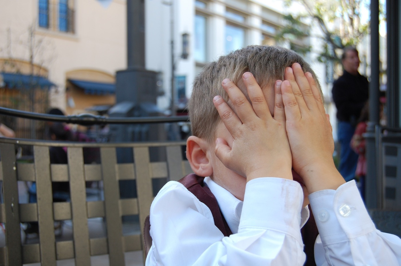 boy hiding face in hands facepalm | the lonely tribalist