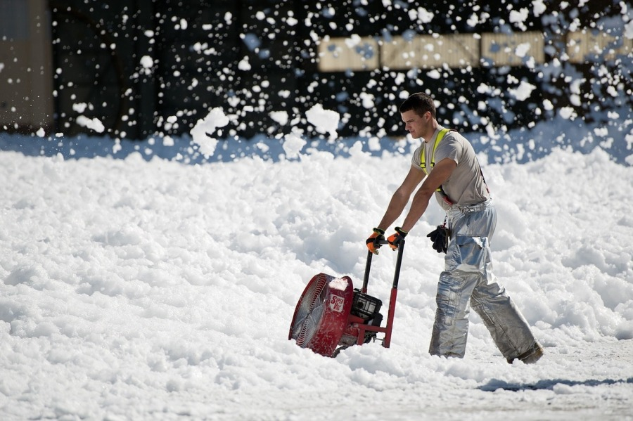 man in blizzard snow blower | the lonely tribalist