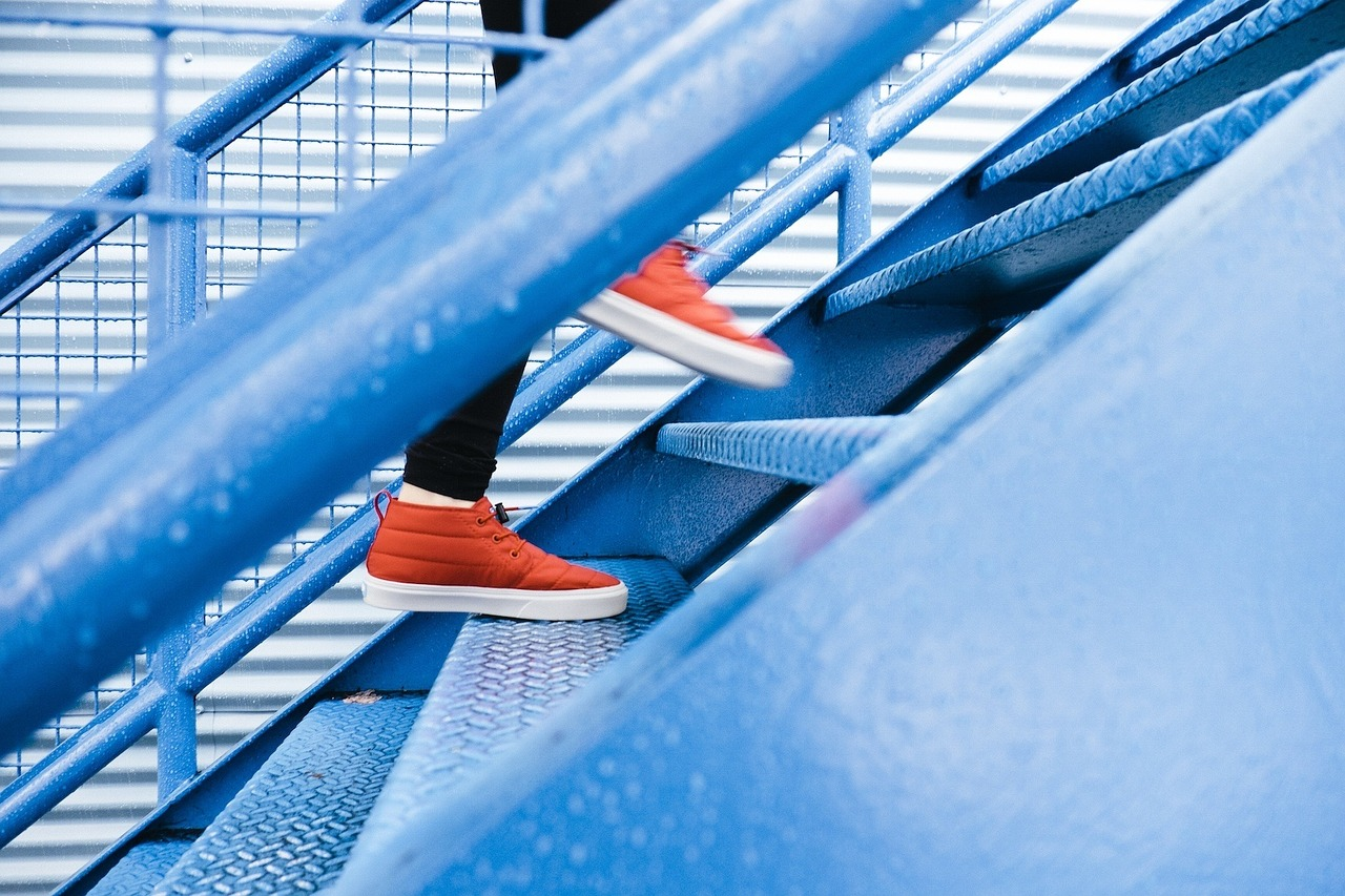running of blue steps stairs | the lonely tribalist