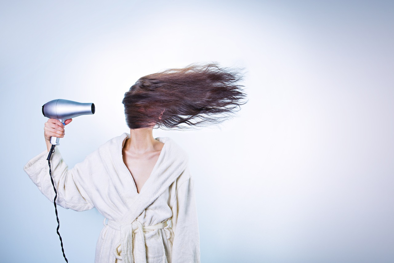 woman blow dry hair in face | the lonely tribalist