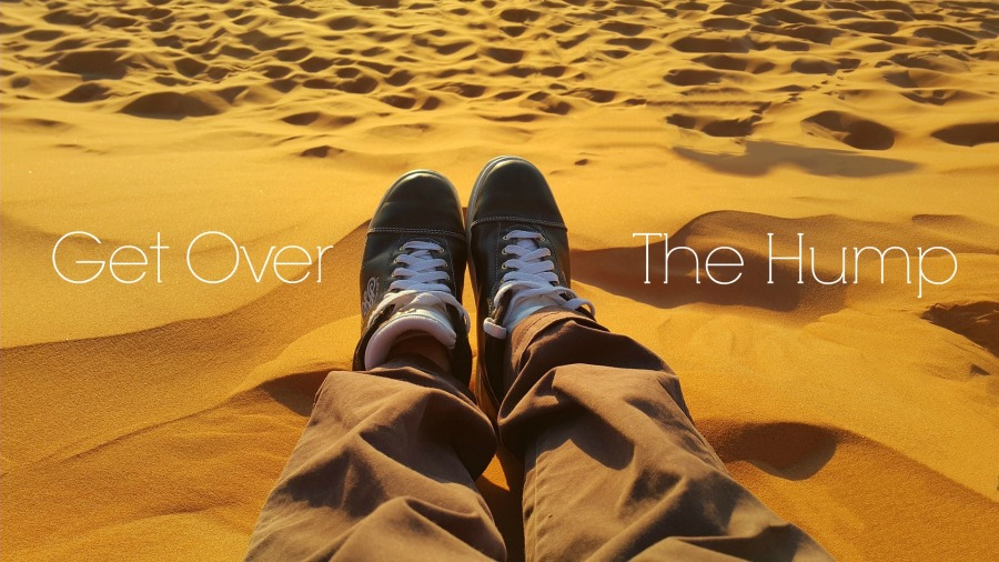 get over the hump sand banner | the lonely tribalist